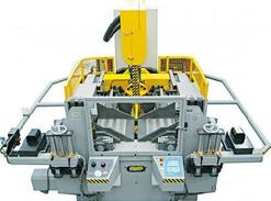 Massive vertical saw head mitering system tilts left to right to a full 60 degrees. Automatic controlled via CNC unit.